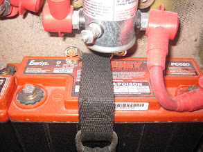 Photo: PC680 batteries held down with nylon webbing and D ring.