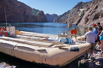 Photo: Out boatman prepares the raft for our boarding. Notice the absolutely perfect weather.