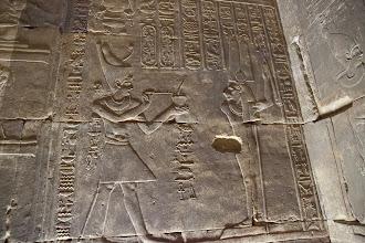 Photo: Horus temple, Edfu - inner vestibule - Ptolemy XII offering to lion-headed Amum-min ?