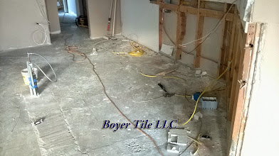 Photo: The start of a very messy process of floor preparation. When that surface is perfectly flat the installation process can begin. The diagonal layout has to flow through those entryways properly. Plan Ahead!