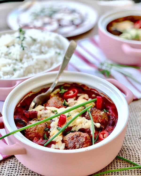 These Chilli Con Meat Balls Is A Delicious Family Meal Consisting Of A Gorgeous Tomato Base Sauce With Homemade From Scratch Meatballs That Are To Die For. Served On/with Rice. Pure Deliciousness!