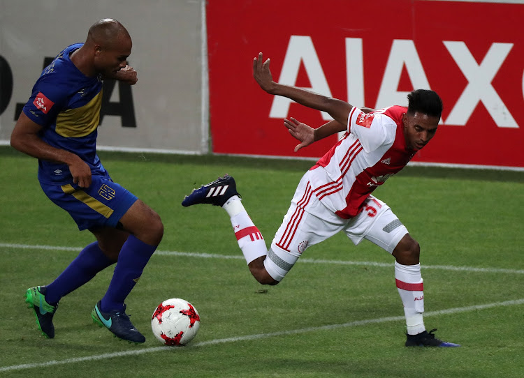 A file photo of Sameegh Doutie during his Ajax Cape Town days in 2017 seen here being tackled by Robyn Johannes of Cape Town City FC during the Absa Premiership match at Cape Town Stadium, Cape Town on February 11 2018.