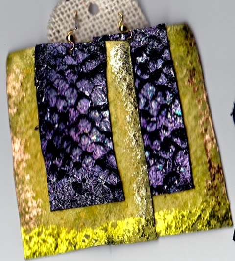 Photo: Yellow & metallic gold painted leather earrings accented with purple/violet/blue colored & foiled fish leather rectangles. Lyris Tracey, Island Mantra, Antigua