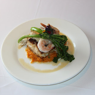 Jerk-crusted Cobia with Sweet Potato Mash and Vanilla Lime Butter Sauce topped with Shrimp and Crab