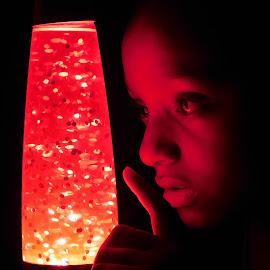 Beautiful in Red by TONY LOPEZ - Babies & Children Child Portraits ( curious, red, girl, curiosity, lava, mysterious, funny, lamp )