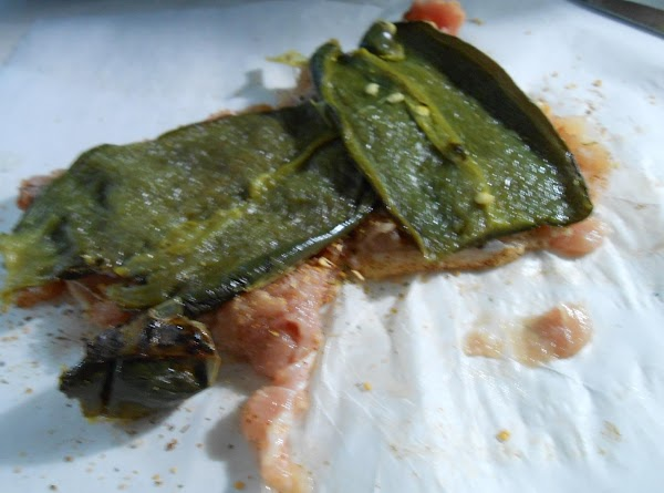 Place two halves of a roasted poblano on top of chicken.