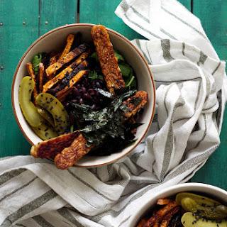 Wild Rice Bowl w/ Crunchy Sweet Potato Fries, Tempeh, Pickles, Arugula + Tahini Sauce