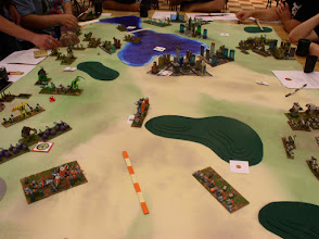 Photo: GUARD forces have split, with the Army and support vehicles moving to block the Molemen, while the rest move aggresively agains the Savage Swarm.