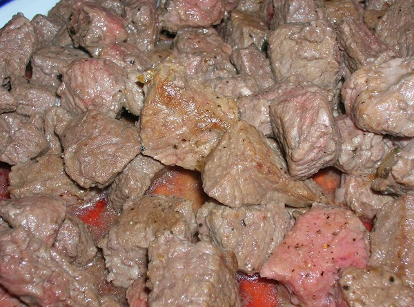 Cut steak into bite sized pieces. Turn up heat under saute pan to high...