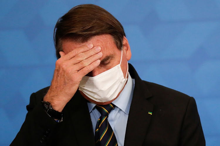 President Jair Bolsonaro in Brasilia, Brazil, March 25 2021. Picture: REUTERS/UESLEI MARCELINO