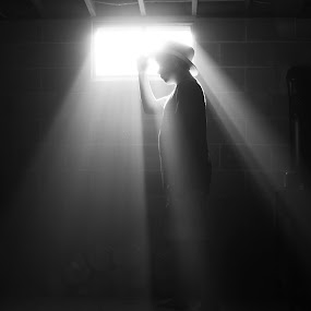 Into the light by Aaron Shaver - People Fine Art ( b&w, dark, mood, atmosphere, light, rays, human )