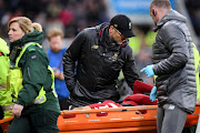 Jurgen Klopp, Manager of Liverpool speaks with Mohamed Salah of Liverpool is carried off the pitch on a stretcher after he gets injured during the Premier League match between Newcastle United and Liverpool FC at St. James Park on May 04, 2019 in Newcastle upon Tyne, United Kingdom.
