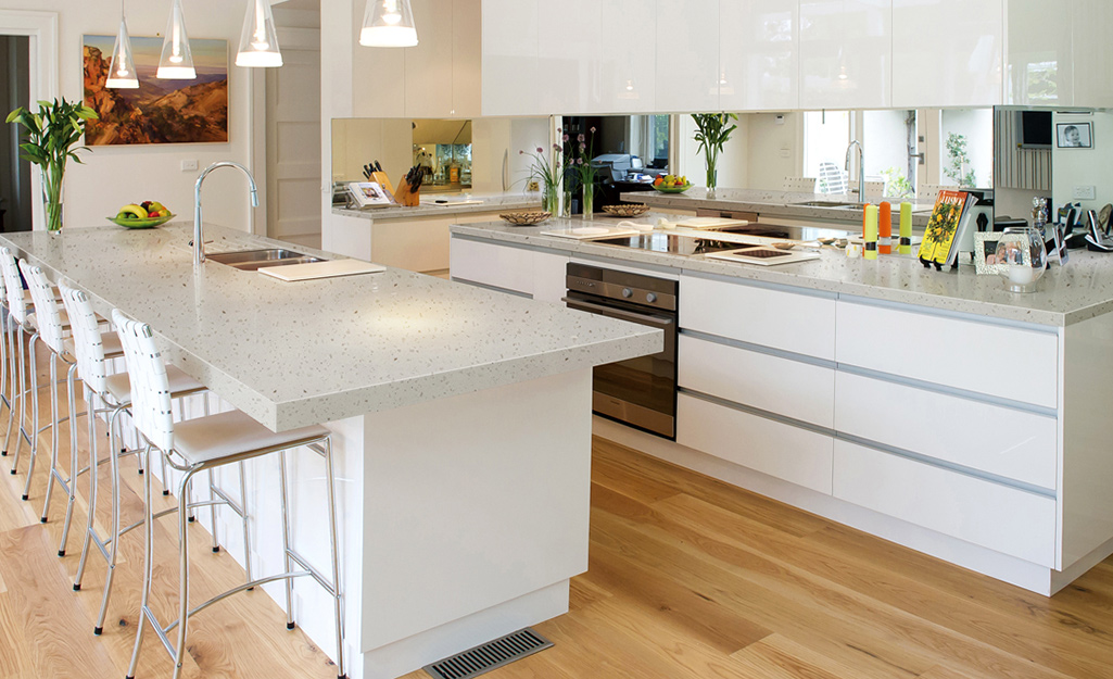 A kitchen with a solid surface countertop.