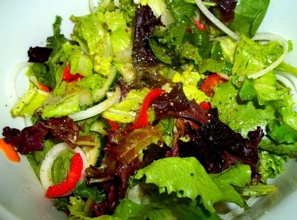 Mix your greens and veggies in a bowl...squeeze half a lemon and drizzle with...