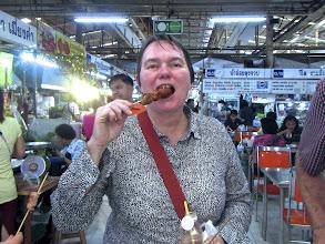 Photo: Jane tasting a sour sausage at Or Tor Kor