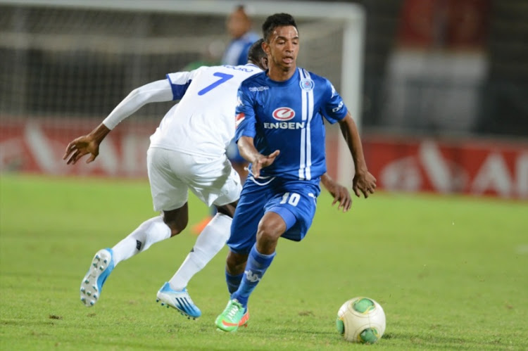 Tendai Ndoro of Black Aces and Sameegh Doutie of SuperSport United during the Absa Premiership match SuperSport United and MP Black Aces at Lucas Moripe Stadium on February 12, 2014 in Pretoria, South Africa.