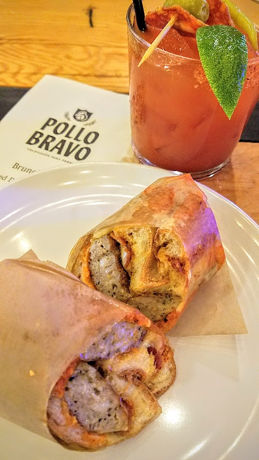 Pollo Bravo brunch at Pine Street Market options of Catalan Sausage Bocadillo with catalan sausage, bacon, mahon, and piquillo peppers with a La Tomatina Bloody Mary with Sobieski vodka, Pollo Bravo Mary mix