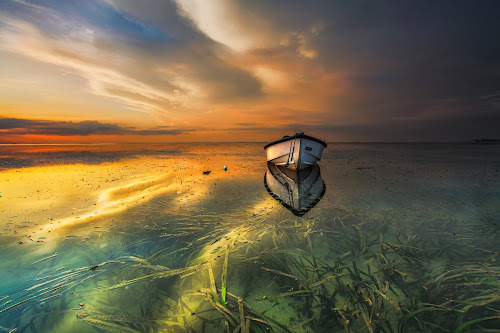 Quite Alone  by Bertoni Siswanto - Landscapes Sunsets & Sunrises ( landscapes, landscape photography, indonesia tourism, sunrise, reflections, canon eos, clouds, morning dew, indonesia, boat, transportation, canon, seascape, bali )
