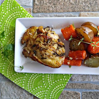 Slow Cooker Garlic Chicken with Baby Potatoes and Carrots.