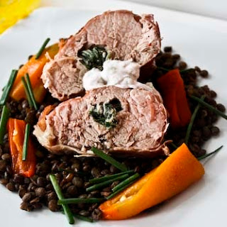 Sage-Stuffed, Prosciutto-Wrapped Pork Tenderloin over Lentil and Scallion Salad