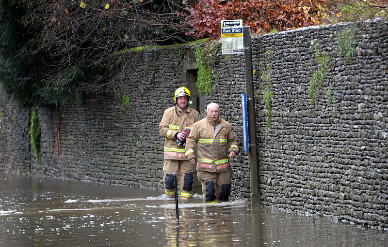 Photo: Fire service personnel negotiate floodwater near Tetbury, Gloucestershire, as motorists were urged to take greater care on Britain's roads today after overnight downpours caused some drivers to abandon their vehicles as public highways flooded. PRESS ASSOCIATION Photo. Picture date: Wednesday November 21, 2012. See PA story WEATHER Floods. Photo credit should read: Tim Ireland/PA Wire