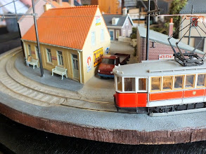 Photo: 008 The tram approaches the tram stop through the town scene .