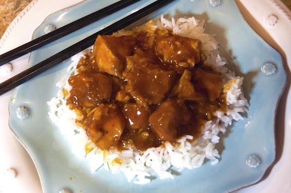 Serve over a mound of white rice, drizzle with that yummy sauce, and garnish...