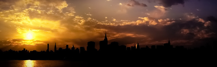 """Photo: """"The New York City skyline in silhouette at sunset...""""  —-  Night pulls its blanket of darkness across the sky as the sun pours the last of its gold over the city.  —- A client requested an 8 foot wide version of this panorama this past weekend. While my main online New York City photography store has this image: http://goo.gl/89s56(along with some of my other panoramas), the lab I use there which is quite wonderful doesn't print up to those dimensions.  Thankfully, another place that I sell my photography online was able to accommodate such a request. Here it is there:  http://fineartamerica.com/featured/new-york-city-skyline-at-sunset-panorama-vivienne-gucwa.html  I am very happy that the requested large version will be on its way to that awesome person soon!  If anyone has requests like this, I always do my best to try to accommodate. To contact me about a request or to ask a question, feel free to email me at my business email: photos@nythroughthelens.com    New York Photography: New York City Skyline at sunset.    You can view this post along with all relevant links here:  http://nythroughthelens.com/post/27334029206/panorama-of-the-new-york-city-skyline-in  -  Tags: #photography  #nyc  #newyorkcity  #newyorkcityphotography  #manhattan  #skyline  #cityscape  #city  #urban  #nycskyline  #newyorkcityskyline  #beautiful  #landscape  #panorama  #nycpanorama"""