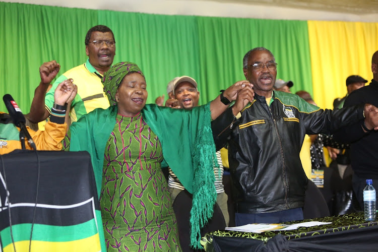 Nkosazana Dlamini Zuma singing with Premier Willies Mchunu at the closing of the ANC PGC in Durban.