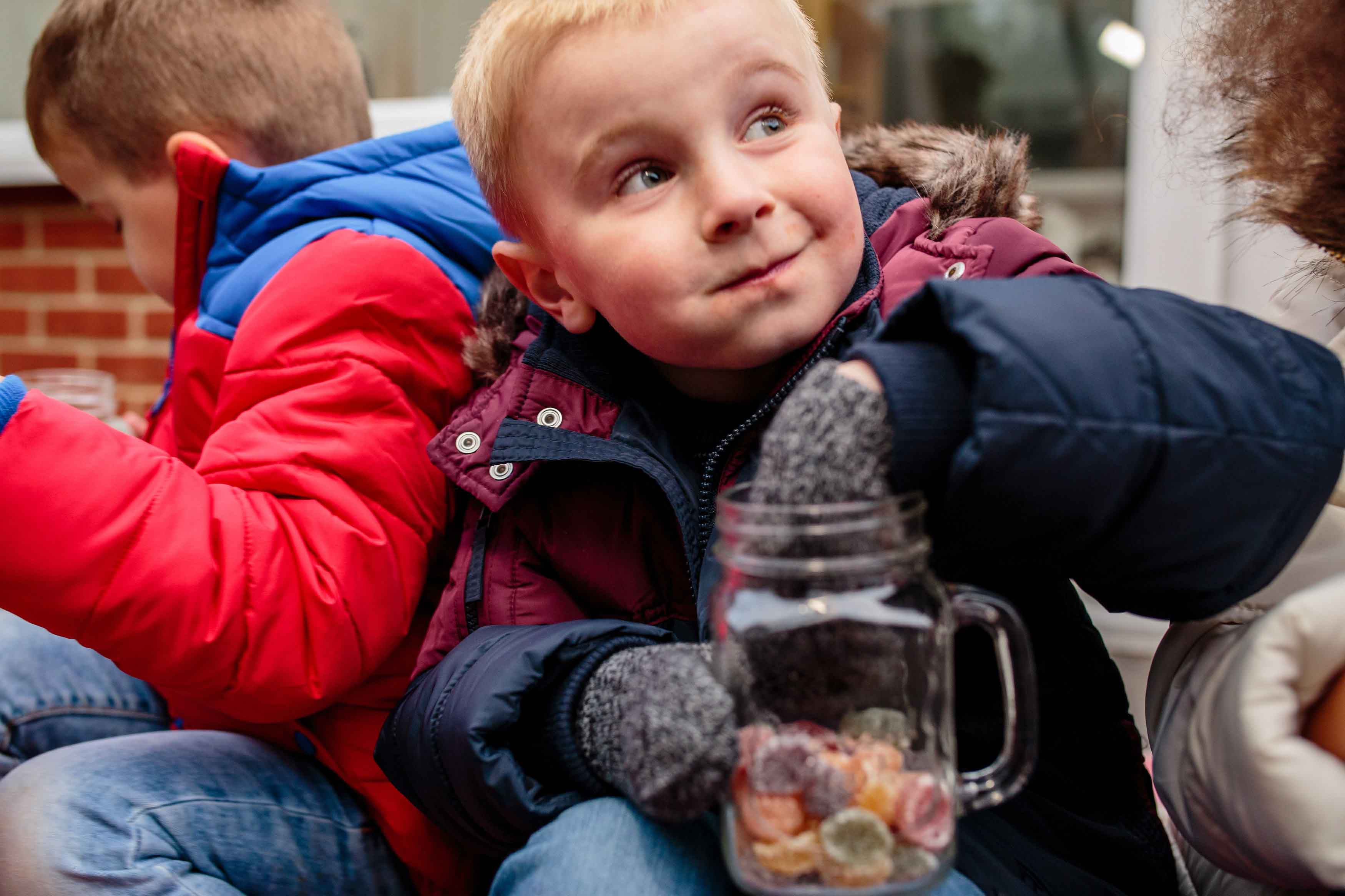 Boy eating sweets from jar