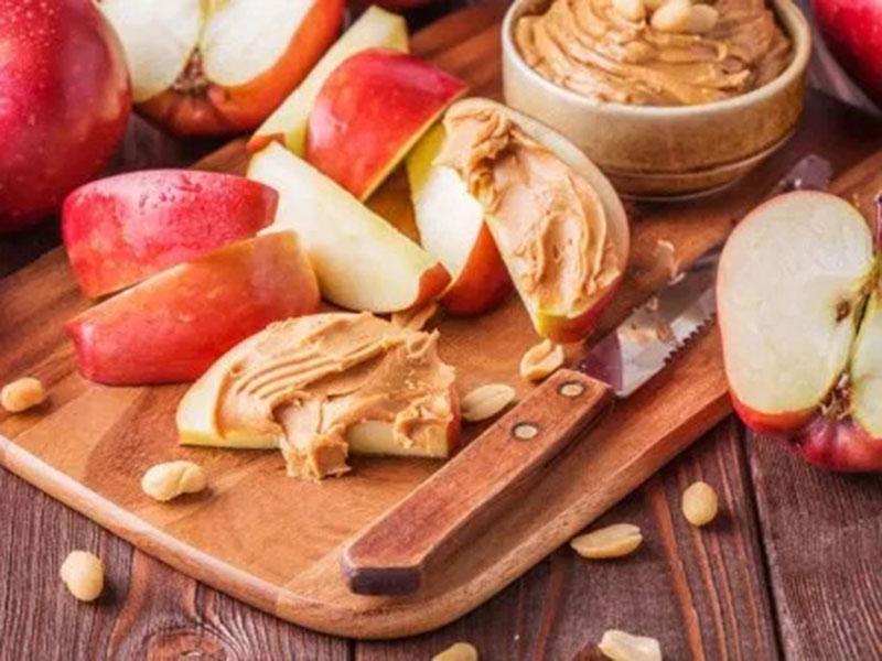 Apples paired with almond butter are a healthy and natural hunger supressing snack.