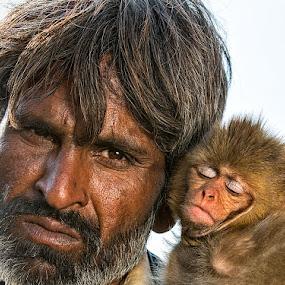 Man & Monkey by Nayyer Reza - People Portraits of Men