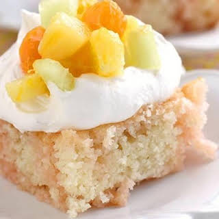 Peach-Mango Sunrise Poke Cake.