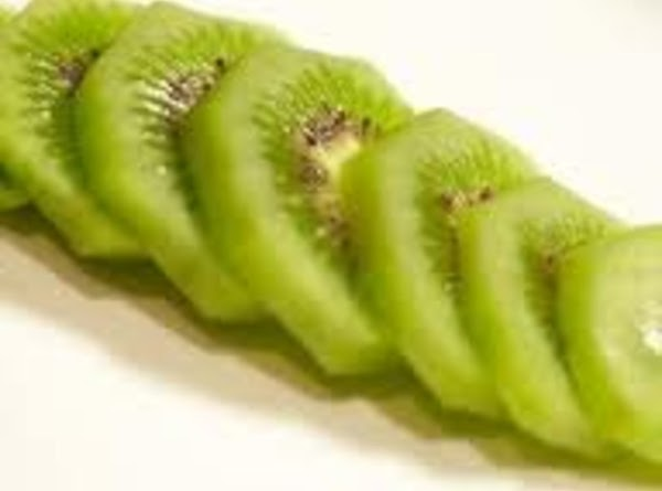 take one kiwi and cut off the black outside part, then cut it to...