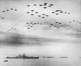 Photo: September 2, 1945: F4U and F6F fighter planes are flying in formation over the USS Missouri, while the surrender ceremonies to end World War II take place aboard the U.S. Navy battleship. (AP Photo)