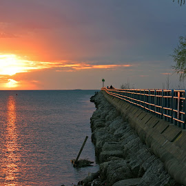 Saginaw Bay Sunset by Bill Diller - Buildings & Architecture Other Exteriors ( calm, michigan, nature, great lakes, breakwall, sunset, calmness, saginaw bay, tranquility, lake huron, water, peaceful )