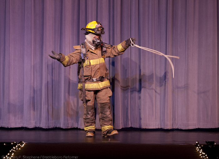 Photo: Brianna Snow demonstrates how to get suited up in bunker gear during the talent portion of the pageant.(Zachary P. Stephens/Brattleboro Reformer)