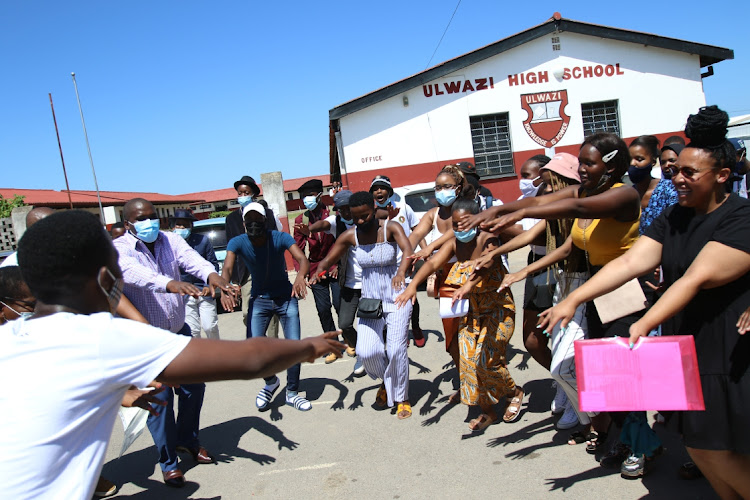 Ulwazi Secondary School pupils celebrate after receiving their matric results on Tuesday.