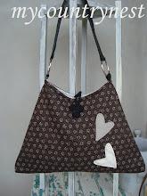 Photo: borsa modello vintage trapezio con cuori