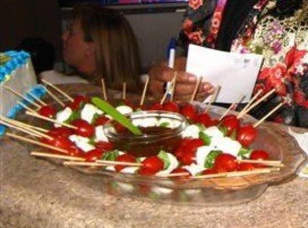 Mini Me Caprese Salad:  grape tomatoes, fresh basil, mini fresh mozzarella balls on...