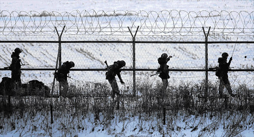 South Korean soldiers check military fences as they patrol near the demilitarised zone separating North Korea from South Korea, in Paju, north of Seoul, yesterday. North Korea conducted its third nuclear test yesterday in defiance of UN resolutions, angering the US Picture: LEE JAE-WON/REUTERS