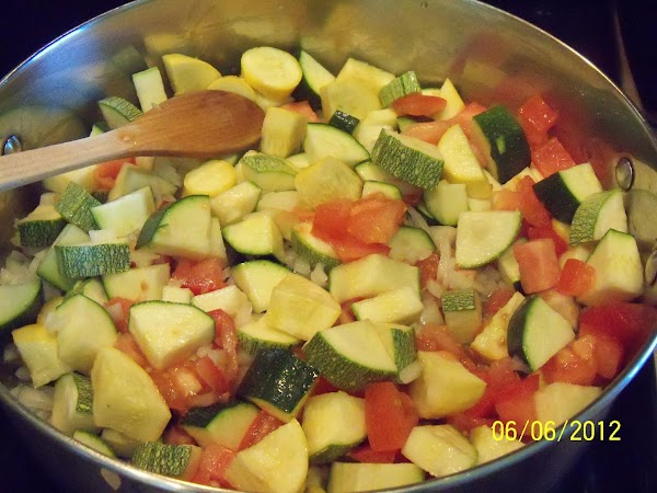 In large pan, add oil, tomato, all squash and onions.  On medium-high heat...