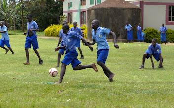 Photo: Back in Kibaale!  Boys love to play soccer.