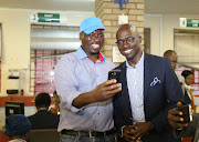 April 23, 2018. Sibusiso Mawota takes  a selfie with Minister Malusi Gigaba at  Department of Home affairs in Pietermaritzburg.