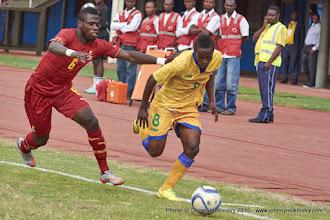 Photo: Haruna NIYONZIMA (8, Capt) outpaces Affriyea Acqua (6) [Rwanda Vs Ghana AFCON2017 Qualifier, 5 Sep 2015 in Kigali, Rwanda.  Photo © Darren McKinstry 2015