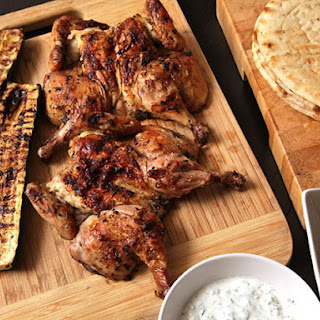 Easy Grilled Cornish Hens and Zucchini with Greek Marinade, Tzatziki, and Greek Salad.