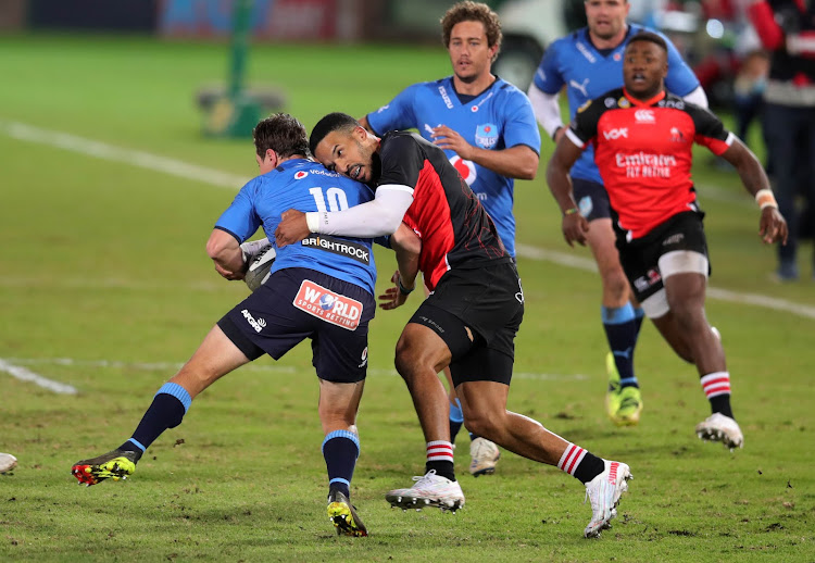Chris Smith, who is tackled by Courtnall Skosan, scored one of the three unanswered tries as the Vodacom Bulls beat the Emirates Lions at Loftus.