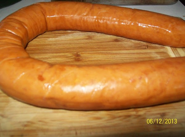Score the kielbasa in ¼ inch spaces all around on both sides and place...