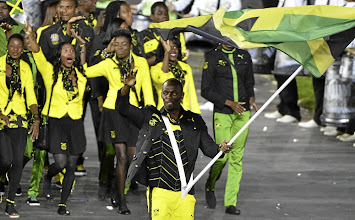 """Photo: Jamaica's Olympic uniforms were designed by a partnership with Puma and Cedella Marley, the daughter of Bob Marley who is a musical icon in her native country. In honor of her father, Marley named the opening-ceremony shirt the """"Buffalo Soldier button-down,"""" and had the words """"Positive Vibrations"""" stitched on the inside of the collar. What do you think about this team's look?"""