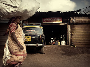 Photo: Loaded Lady ... with one of Mumbai's finest taxis in the background. I think she's doing a better job at transporting something than the taxi. www.michiel-delange.com #streetphotography  #streetphotographers